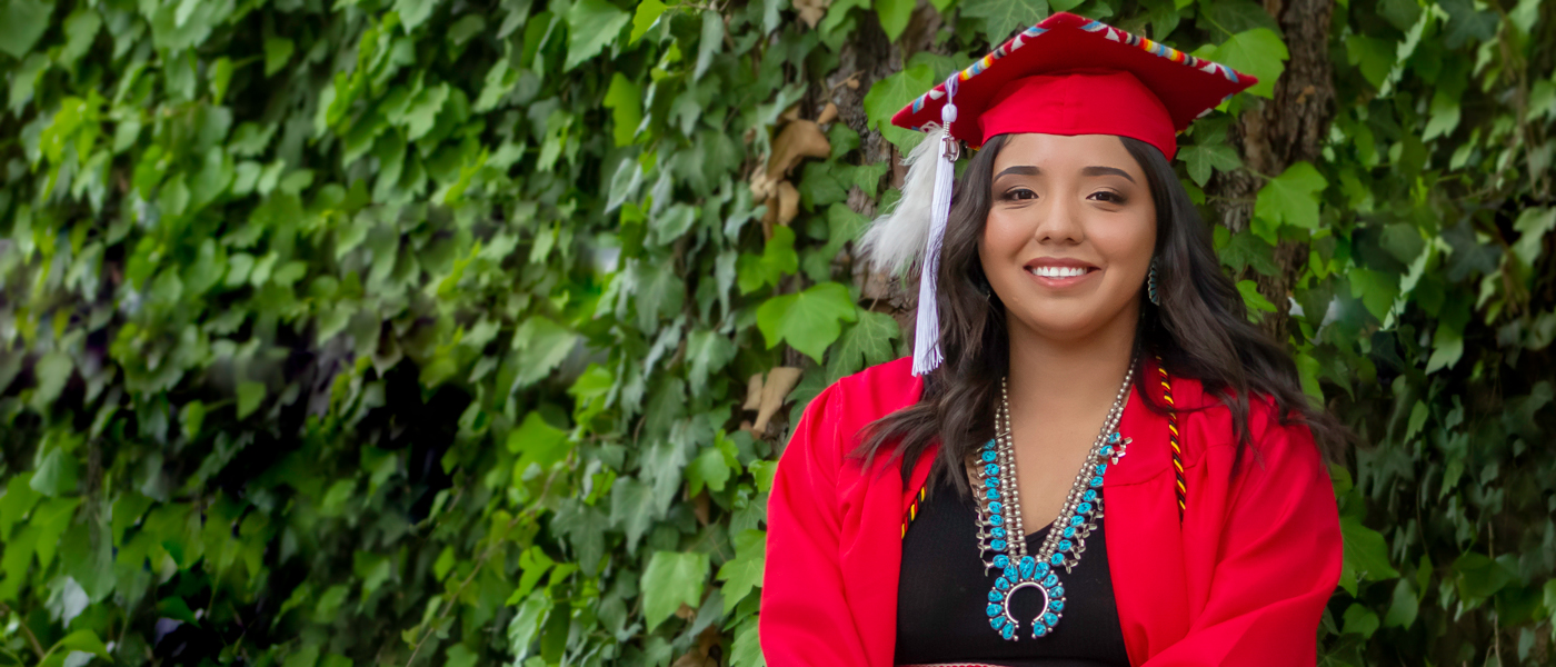 Help Native American students like Elisha continue their education...