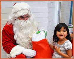Santa and Native American child